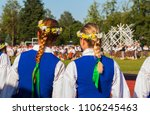 girls in national costumes at a ... | Shutterstock . vector #1106245463