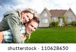 happy family near new house.... | Shutterstock . vector #110628650