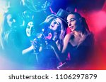 Stock photo dance party with group people dancing women and men have fun in night club back light on girls 1106297879