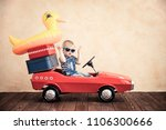 funny baby boy playing at home. ... | Shutterstock . vector #1106300666