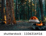 camping in the the woods of...