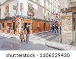 Small photo of Paris / France - May 18, 2018: People wander the beautiful, quaint, colorful streets of the famous and popular Saint-Germain des Pres neighborhood, in Paris' Left Bank.