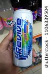 Small photo of Klang, Malaysia - June 2, 2018 : Hand hold a isotonic can drink of REVIVE original flavour in the supermarket.