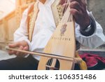 a busker plays traditional... | Shutterstock . vector #1106351486
