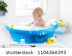 happy laughing baby taking a... | Shutterstock . vector #1106366393