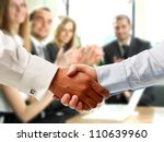 handshake on the background of applause - stock photo