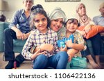 muslim family relaxing and... | Shutterstock . vector #1106422136