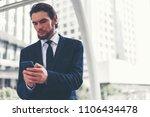 businessman holding smartphone. ... | Shutterstock . vector #1106434478