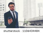 businessman holding smartphone. ... | Shutterstock . vector #1106434484