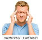 Worried young man suffering from headache - stock photo