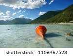 orange buoy at the beach of... | Shutterstock . vector #1106467523