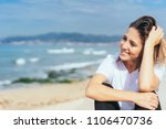 smiling happy relaxed woman at... | Shutterstock . vector #1106470736
