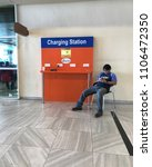 Small photo of Kuching, Malaysia - May 10 2018: Passenger charge their phones at a charging station inside the Kuching International Airport.