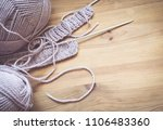 knitting needles and yarn on... | Shutterstock . vector #1106483360