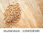 wheat grains on a wooden...   Shutterstock . vector #1106528180