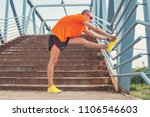 young man stretching on a fence ... | Shutterstock . vector #1106546603