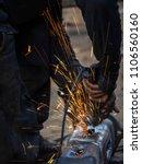 metal work. man grinds a steel... | Shutterstock . vector #1106560160
