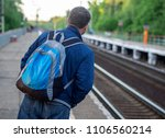 tourist man with a backpack on... | Shutterstock . vector #1106560214