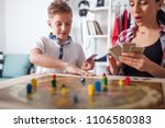 mother and son playing modern... | Shutterstock . vector #1106580383