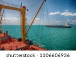 cargo ship sailing in high sea   Shutterstock . vector #1106606936