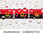 flags  of angola behind a glass ... | Shutterstock . vector #1106642714