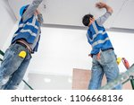 construction worker ceiling work | Shutterstock . vector #1106668136