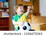 little blond adorable kid boy... | Shutterstock . vector #1106675363