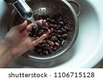 Small photo of Kyiv, Kyiv Oblast / Ukraine - 21 01 2018: horizontal photo of hand holding beans that are rinsed with a stream of water through a sieve in a white sink