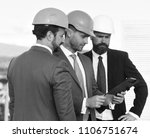 builders at the construction... | Shutterstock . vector #1106751674
