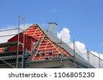 tiling a roof | Shutterstock . vector #1106805230