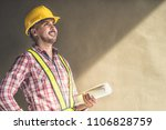handsome engineer holding... | Shutterstock . vector #1106828759