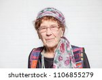 elderly woman. studio shot.... | Shutterstock . vector #1106855279