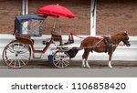 brown horse with red umbrella... | Shutterstock . vector #1106858420