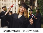 young smiling woman on her... | Shutterstock . vector #1106946833
