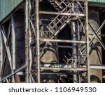 Small photo of Old factory closeup. Fragment. Industrial background. Metalware. Stairs