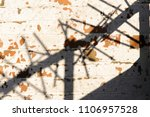 shadow of security spikes on... | Shutterstock . vector #1106957528
