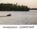 fishing boat motor on lake...   Shutterstock . vector #1106957609