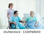 nurse reassuring her patient on ... | Shutterstock . vector #1106968643