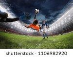 soccer striker hits the ball... | Shutterstock . vector #1106982920