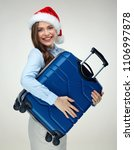 santa girl holding blue travel... | Shutterstock . vector #1106997878