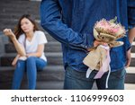 man holding flower bouquet to... | Shutterstock . vector #1106999603