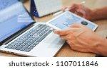 close up business man hand hold ... | Shutterstock . vector #1107011846