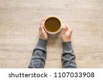 female hand holding a cup of... | Shutterstock . vector #1107033908