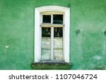 old window on the green wall | Shutterstock . vector #1107046724