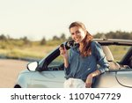 young pretty woman standing... | Shutterstock . vector #1107047729