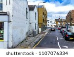 Small photo of Old Lassell and Orlop street with buildings in british style at Greenwich. London. UK. Shot from Trafalger road