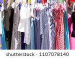 showcase with dresses | Shutterstock . vector #1107078140