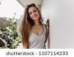 carefree caucasian girl with... | Shutterstock . vector #1107114233