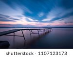 jetty in sunset with long... | Shutterstock . vector #1107123173