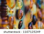 macro close up shot of an amber ... | Shutterstock . vector #1107125249